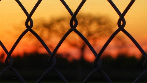 Barbed wire surrounding a prison fence