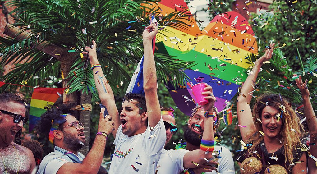 A pride parade in the streets of a city