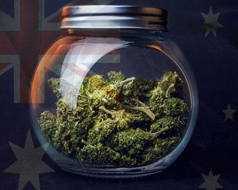 Jar of cannabis over an Australian flag