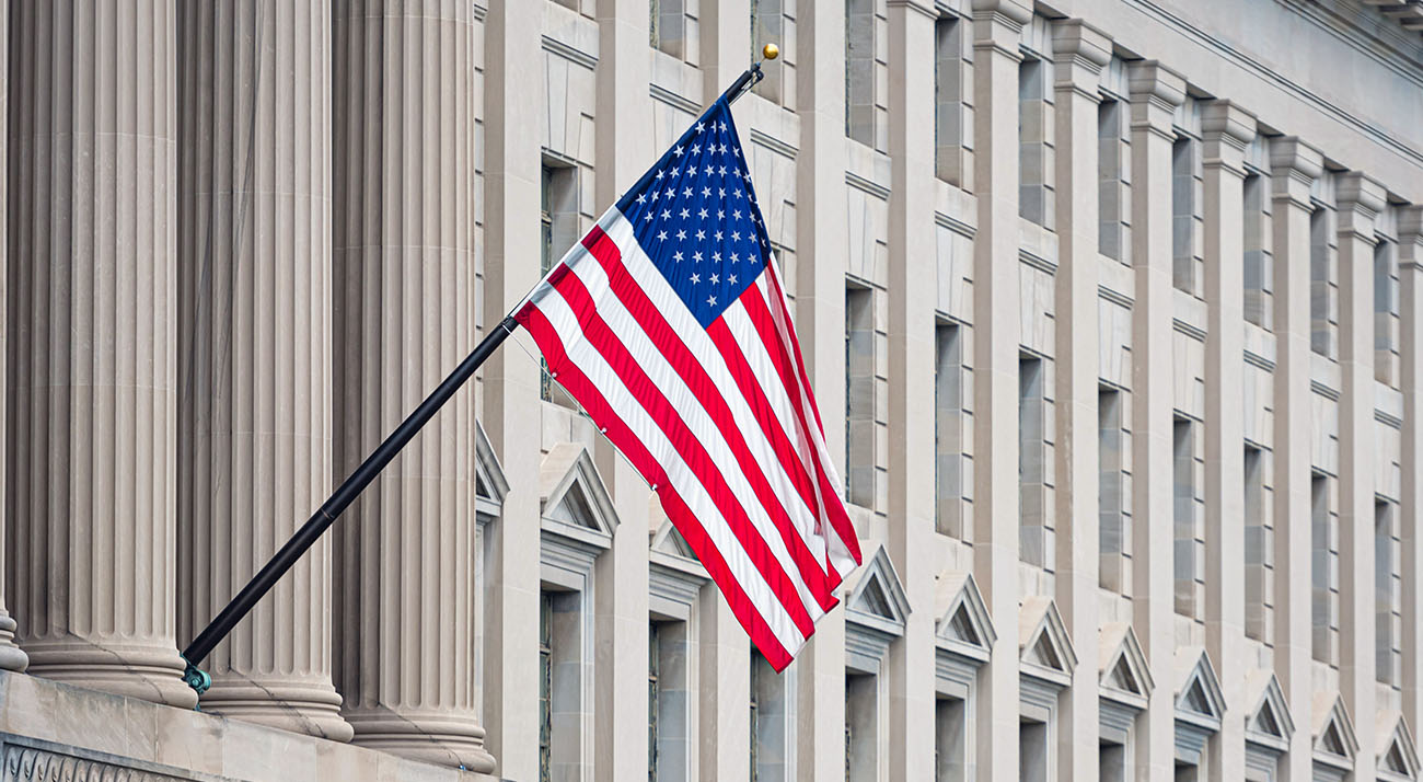 American flag hanging from a building