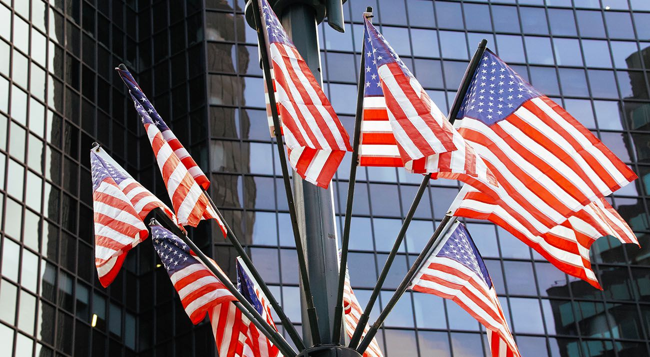 USA flags in front of a building