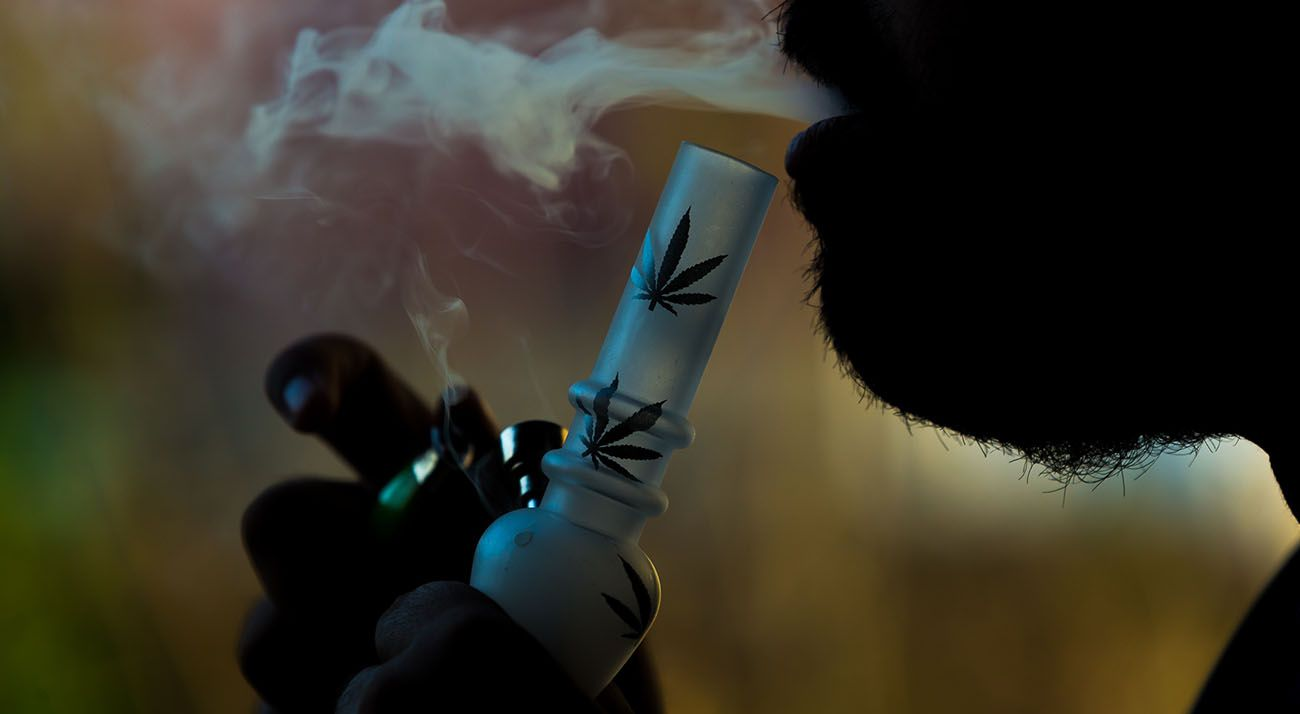 Man smoking a bong