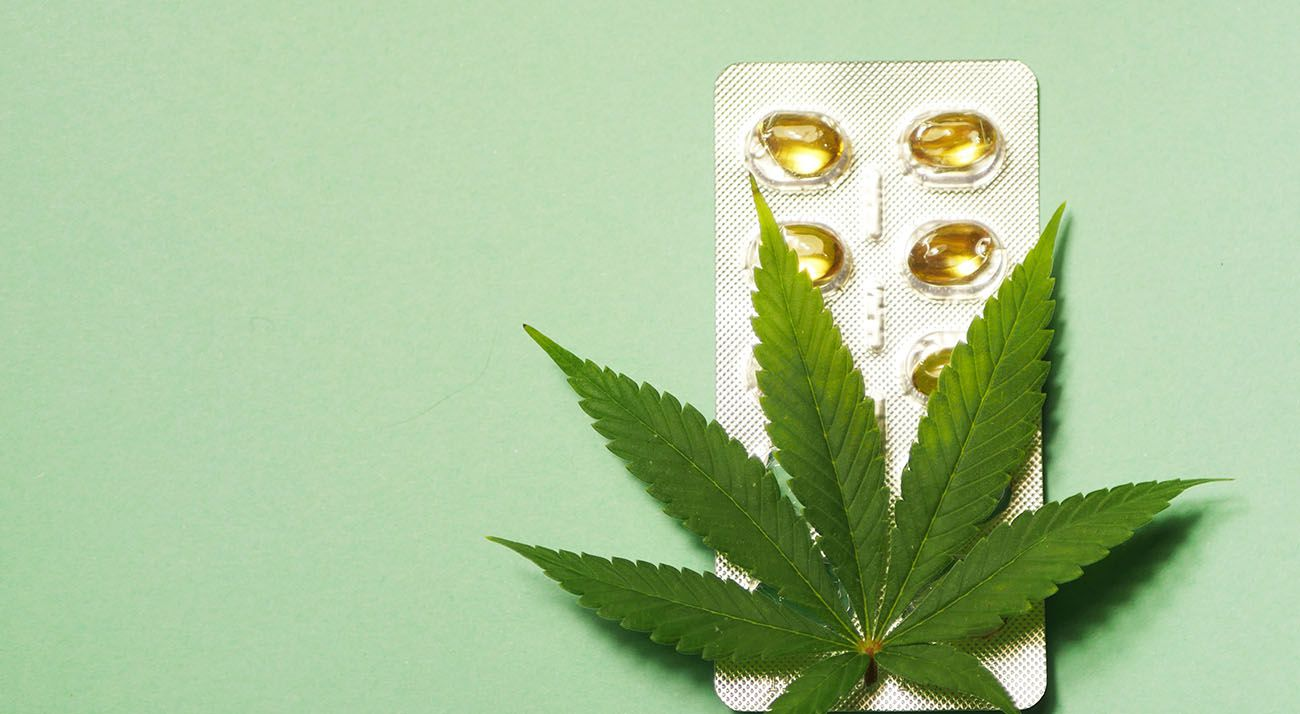 Cannabis leaf on top of pills