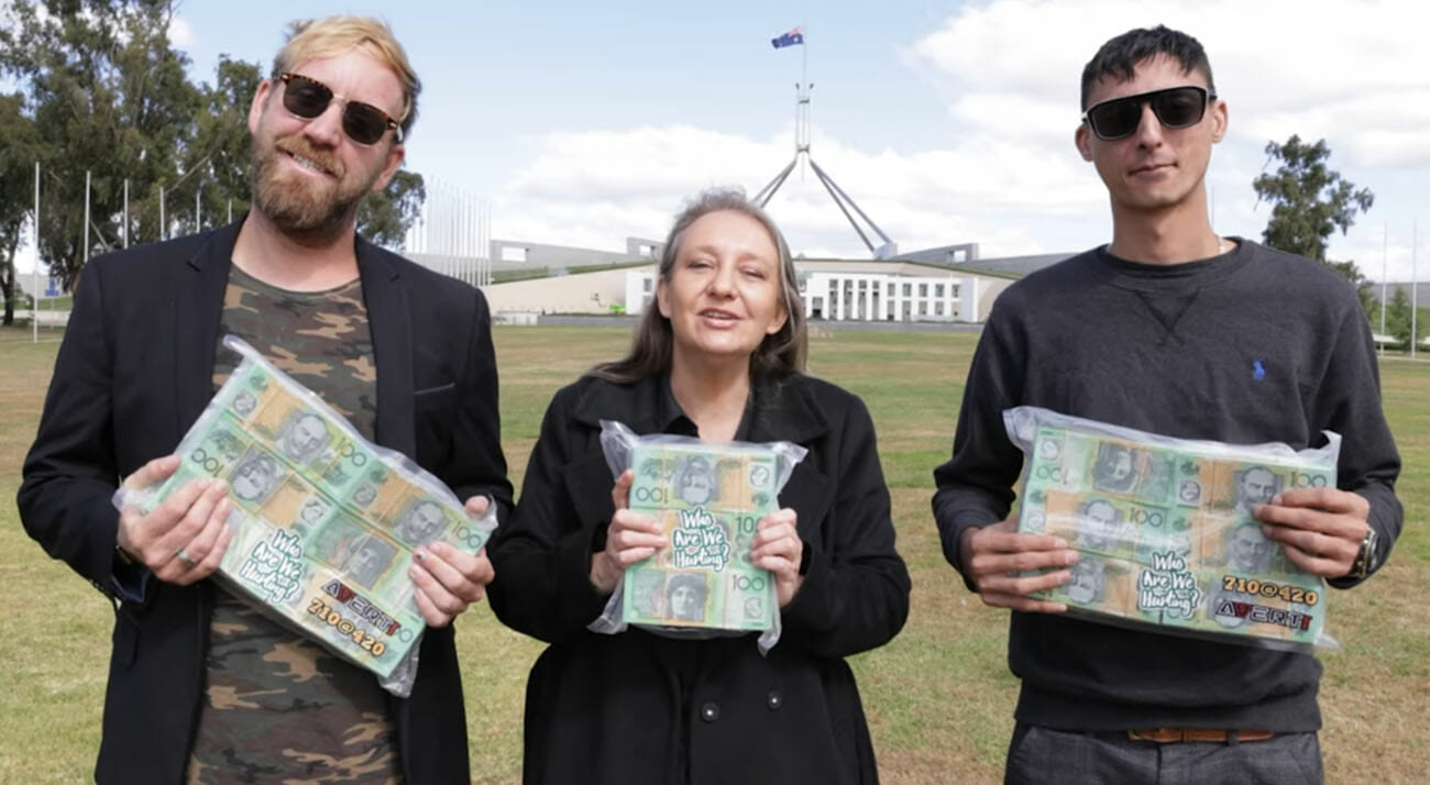 Australian cannabis activists pose in front of Parliament House