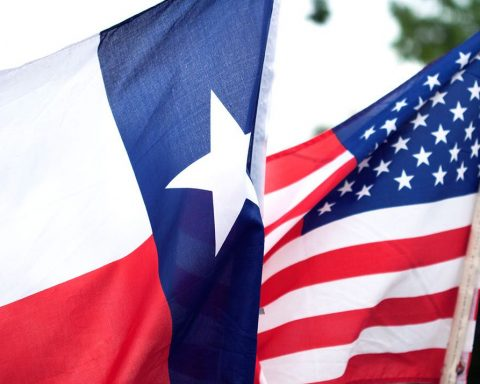 Texan and American flag