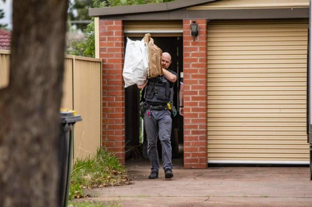 Australian police seizing cannabis from a grow house
